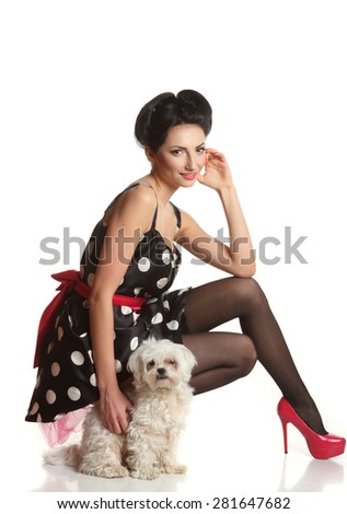 beautiful girl with a dog on a white background . stylish hairstyle, beautiful figure, stylish makeover. pin-up girl  - stock photo