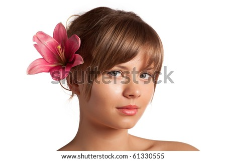 Beautiful girl with a flower - stock photo