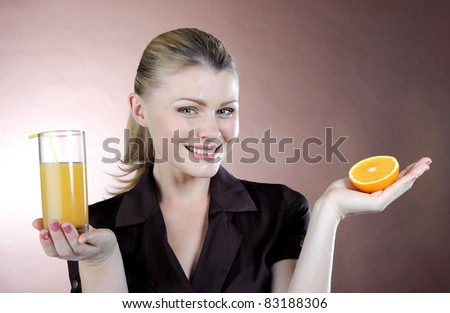 beautiful girl with a glass of orange juice