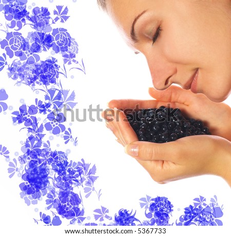 Beautiful girl with a handful of blueberries - stock photo