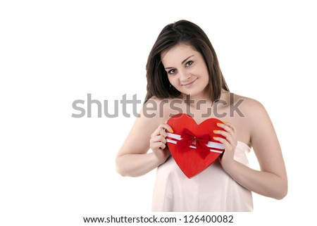 Beautiful girl with a heart in her hands isolated on white studio shot