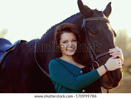 Beautiful girl with a horse - stock photo