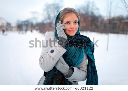 Beautiful girl with a mobile phone - stock photo