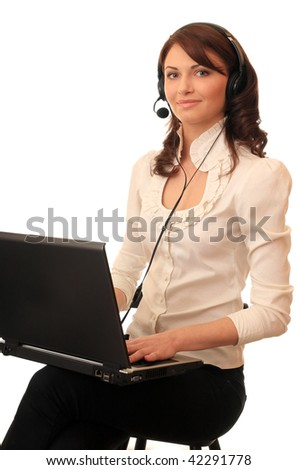 Beautiful girl with a notebook in headsets with a microphone. - stock photo