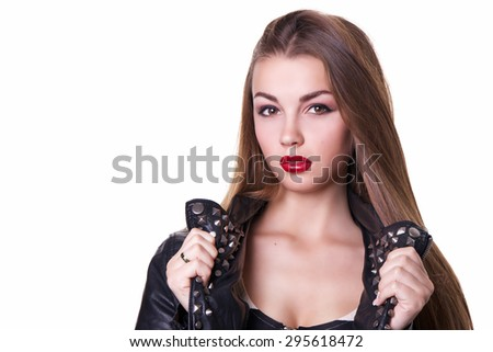 Beautiful girl with a red lipstick dressed in a black leather jacket. Isolated over white background.  Copy space. - stock photo