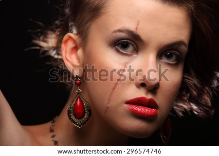 beautiful girl with a scar on face and shoulder studio - stock photo