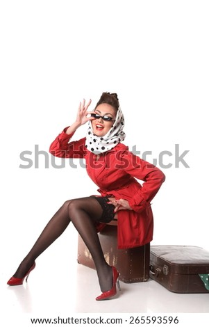 beautiful girl with a suitcase on a white background . stylish hair and stylish make-up. bright emotions. pin-up girl  - stock photo