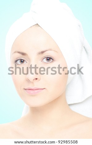 Beautiful girl with a towel around her head - stock photo