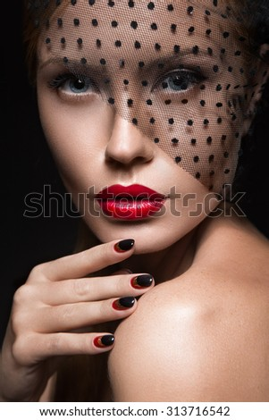 Beautiful girl with a veil, evening makeup, black and red nails. Design manicure. Beauty face. - stock photo
