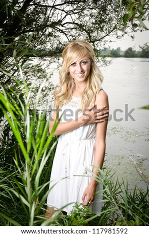 beautiful girl with a white dress in the nature - stock photo