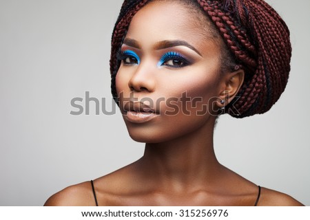 beautiful girl with African roots on a white background - stock photo