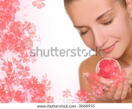 Beautiful girl with an aroma bath ball - stock photo
