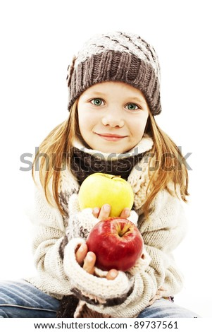 Beautiful girl with apple. Winter style. - stock photo