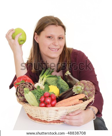 beautiful girl with  basket of fresh vegetables