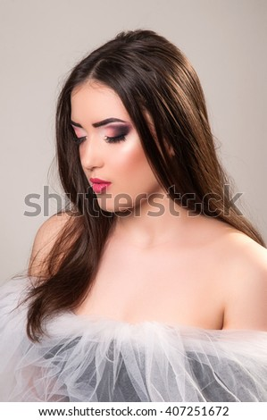 Beautiful girl with beautiful makeup, youth and skin care concept. Attractive brunette girl in studio - stock photo