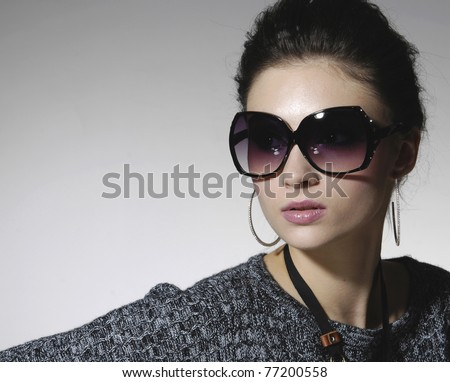 beautiful girl with big black glasses-close up - stock photo