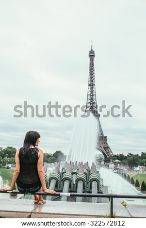 beautiful girl with big breasts and blond hair in Paris on a background of the Eiffel Tower