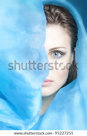 beautiful girl with blue cloth evolving - stock photo