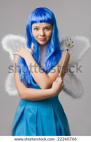 Beautiful girl with  blue hair and  in blue dress with open-air look fold one's hand - stock photo