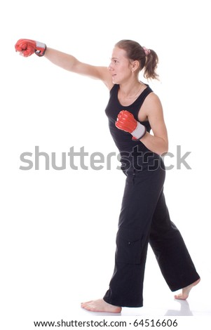 Beautiful girl with boxing gloves. Isolated