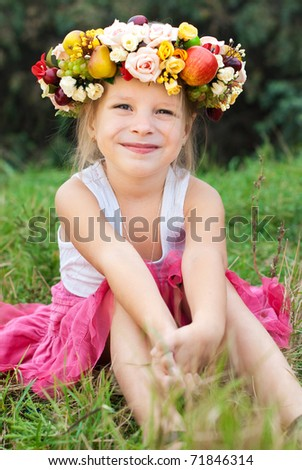Beautiful girl with bright wreath - stock photo