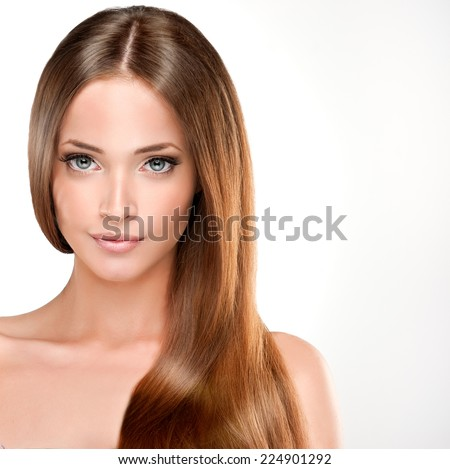 Beautiful girl with brown hair . Long straight hair Shine with health. - stock photo