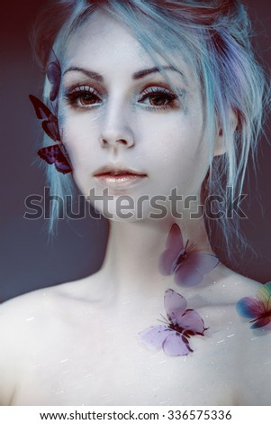 Beautiful Girl With  Butterfly. Beauty Face. Creative Make up and Hair Style. portrait with blur - stock photo