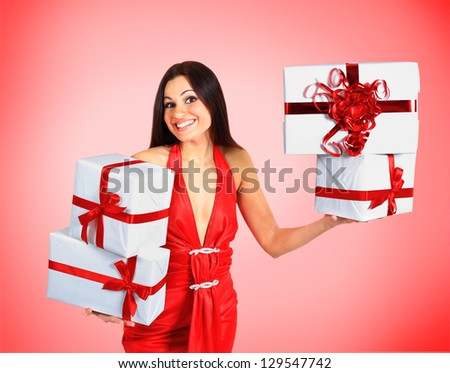 Beautiful girl with Christmas presents. - stock photo