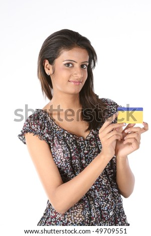 Beautiful girl with credit card - stock photo