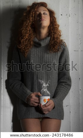Beautiful girl with cup of coffee, hot chocolate or tea.  - stock photo