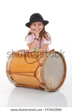 Beautiful girl with drum isolated on white background
