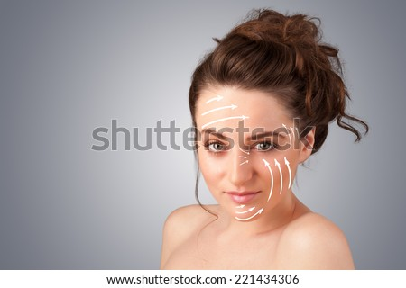 Beautiful girl with facial arrows on her skin on gradient background - stock photo