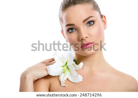 Beautiful girl with flower looking at camera, close up, isolated over white