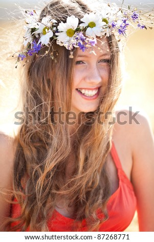 Beautiful girl with flower wreath - stock photo