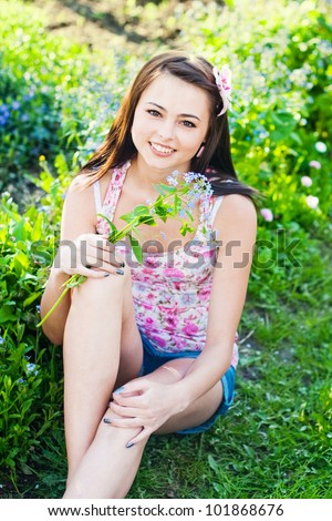 Preteen Girl On Grass Background Royalty Free Stock Image