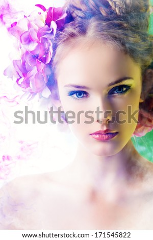 Beautiful girl with flowers in her hair. Spring. - stock photo