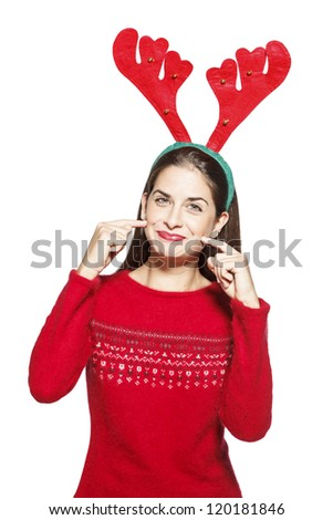 Beautiful girl with funny Christmass reindeer ears. On white background - stock photo