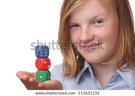 Beautiful girl with gambling dices on white background - stock photo