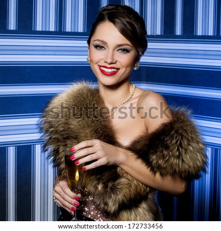 Beautiful girl with glass of champagne - stock photo
