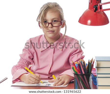 Beautiful girl with glasses, a desk - stock photo