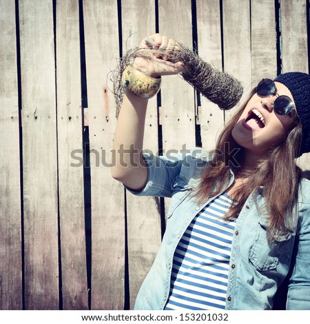 beautiful girl with glasses singing outdoor, young singer, toned image - stock photo