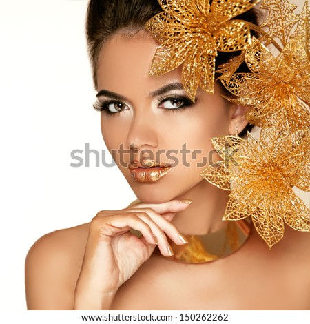 Beautiful Girl With Golden Flowers. Beauty Model Woman Face. Perfect Skin. Professional Make-up. Makeup. Fashion Art - stock photo