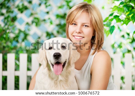 Beautiful girl with golden retriever