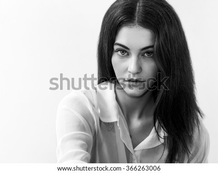 Beautiful girl with gorgeous eyes portrait black and white - stock photo