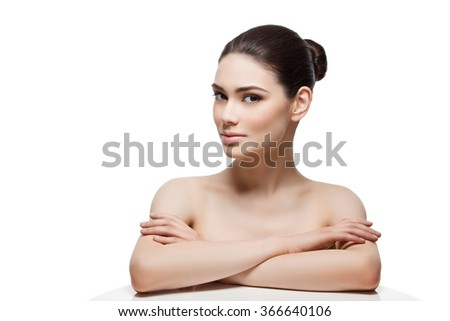 Beautiful girl with hands on shoulders - stock photo