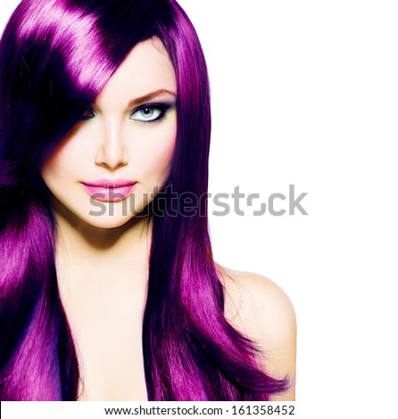 Beautiful Girl with Healthy Long Purple Hair and Blue Eyes. Beauty Model Woman with Professional Makeup, Red lipstick. Hairstyle. Stylish Haircut. Fringe. Smooth Fashion Hair. Hair Coloring  - stock photo