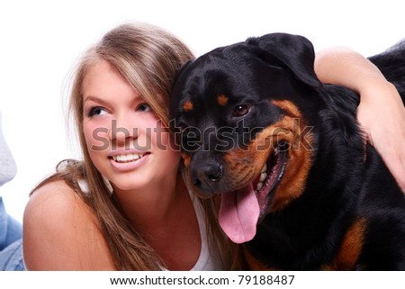 Beautiful girl with her cute dog on white - stock photo