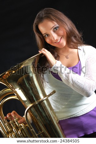 Beautiful girl with her musical instrument tuba. - stock photo