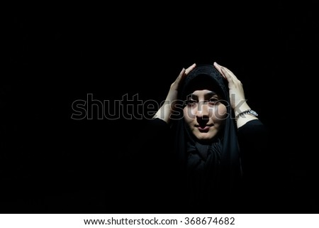 Beautiful girl with hijab on black background