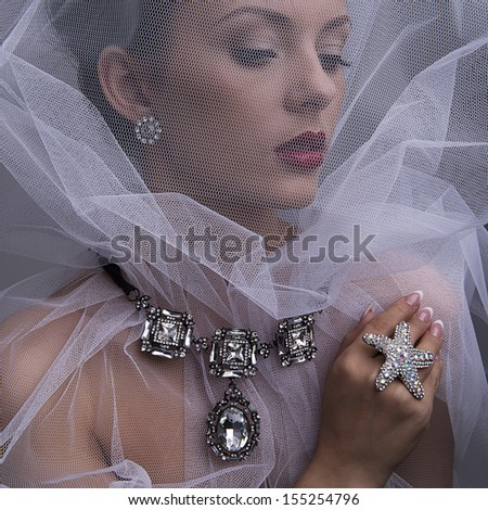 beautiful girl with jewelry with fabric - stock photo